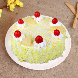Half kg pineapple cake with juicy fruit chunks and cherry