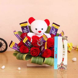 Gift Combo of 10 Cadbury Dairy Milk + 10 Red Roses + 1 Teddy(6 inch) In a Box Arrangement+1 rakhi