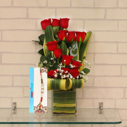 Wow Rakhi combo of 12 red roses in vase + One Rakhi