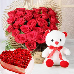 50 red roses 6 inch teddy half kg heart shape cake