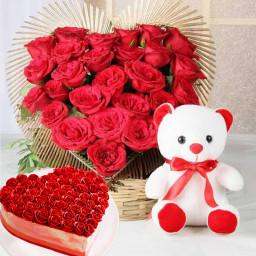 50 red roses 6 inch teddy half kg heart shape cake