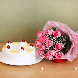 Combo of 8 Pink Roses and Half Kg Pineapple Cake