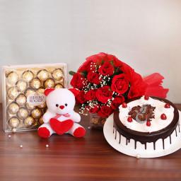 Combo Gift of 10 Red Roses + Half Kg Black Forest Cake + 24 pc Ferrero Rocher + Teddy