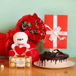 Combo Gifts Of 12 Red Roses + 16pcs Ferrero Rocher Box +Half Kg Chocolate Cake +Greeting Card +Teddy
