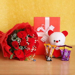 Lovely Combo of 10 Red Roses + 2 Cadbury Dairy Milk + Two 5 Star Chocolate + Greeting Card + A White Teddy