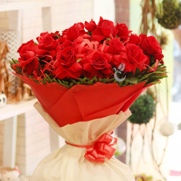 30 Red Roses in red and white paper packing