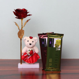 Precious gift combo of 1 Golden Red Rose with 6 inch teddy and 2 Temptation Chocolates