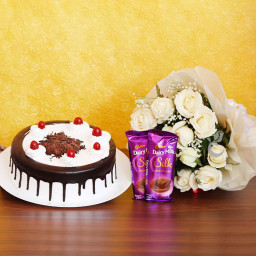 Combo Gift of 12 White Roses with Half kg Blackforest Cake and 2 Dairy Milk Silk