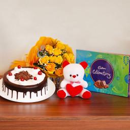 Combo Gift of 12 Yellow Roses Bunch +Half kg Blackforest  Cake +1 Celebration + Teddy