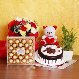 Combo Gift of 12 Mix Carnation + Half kg Black Forest Cake + Bamboo + Teddy + 24 Ferrero Rocher