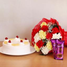 Fabulous Combo GIift of  12 Mix Carnation + Half Kg Pineapple Cake + 2 Dairy Milk Silk